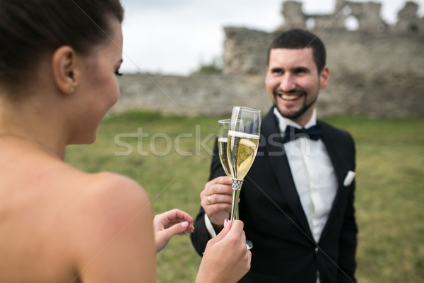 bridal couple clink glasses of champagne Stock photo © tekso