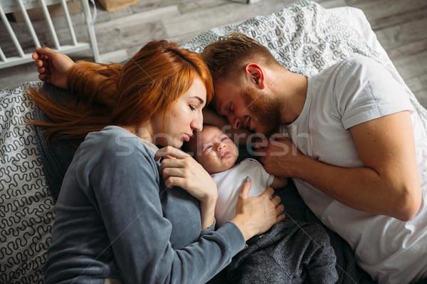 Fiatal szülők figyelem baba összes ül Stock fotó © tekso