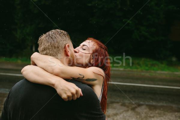 Gyönyörű pár csók eső kívül út Stock fotó © tekso