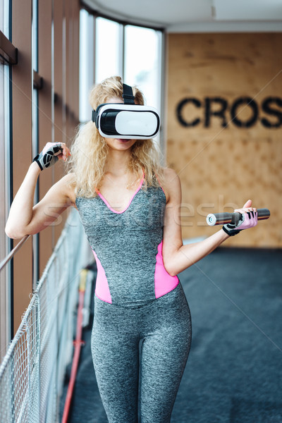 Beautiful girl in the gym with VR headset Stock photo © tekso