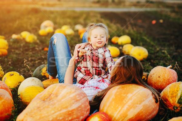 Anya lánygyermek hazugság tökök mező halloween Stock fotó © tekso
