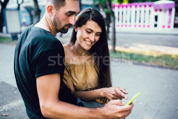 Couple watching something on a smart phone Stock photo © tekso