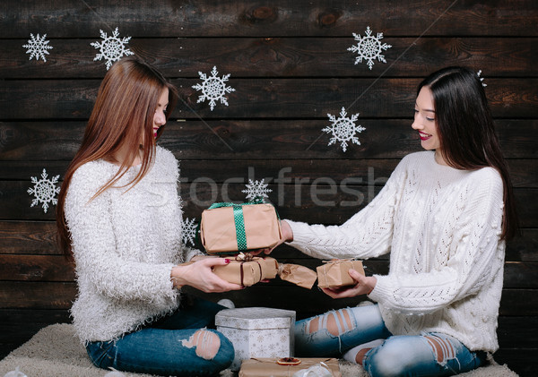 two beautiful girls together unpack gifts Stock photo © tekso