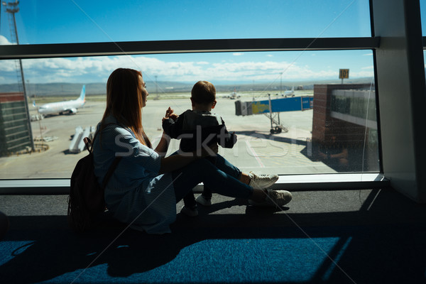 Little boy and his mother sitting in an airport Stock photo © tekso