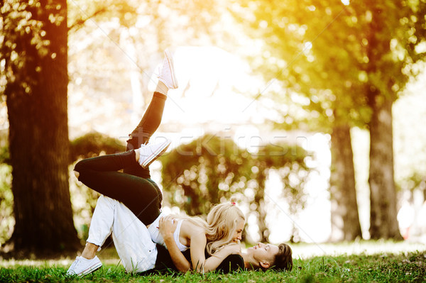 Stock photo: couple laying on the grass