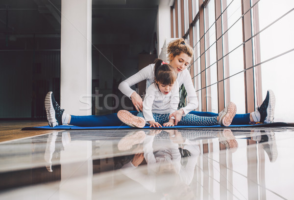 Mother and daughter hugs in the gym Stock photo © tekso