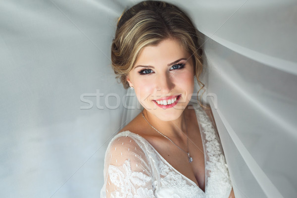 Bride posing in a hotel room Stock photo © tekso