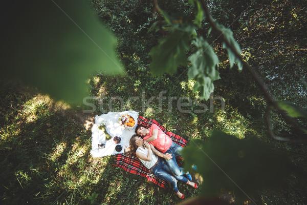 Couple on a picnik Stock photo © tekso