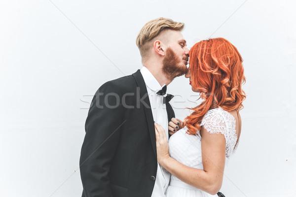 Wedding couple on a background of whitewall Stock photo © tekso