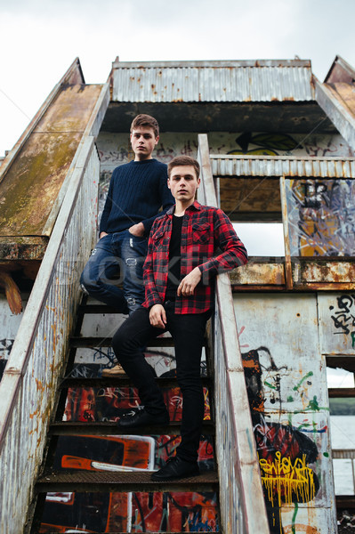 two guys stand in an abandoned building Stock photo © tekso