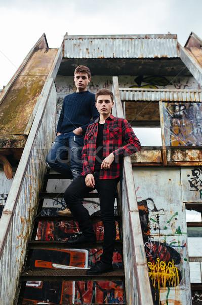 два стоять заброшенный здании молодые Сток-фото © tekso