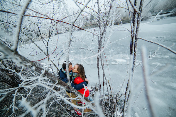 beautiful couple posing near a frozen river Stock photo © tekso
