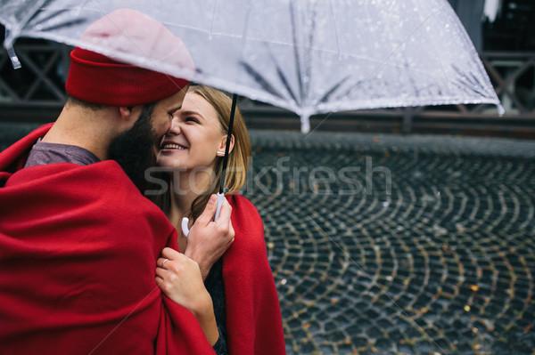 парень девушки зонтик позируют вместе дождь Сток-фото © tekso