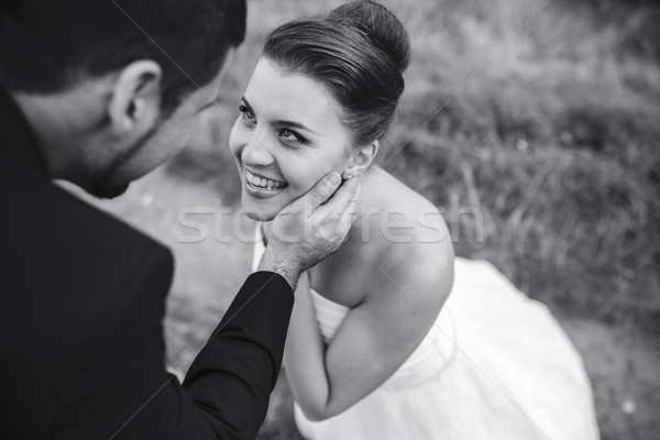 groom gently touches the face of his bride Stock photo © tekso