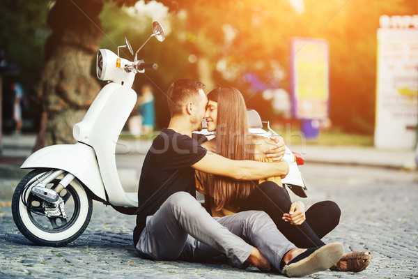 Cute couple with their scooter in the city Stock photo © tekso