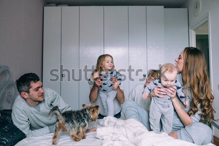 Stock photo: Happy family playing together on the floor