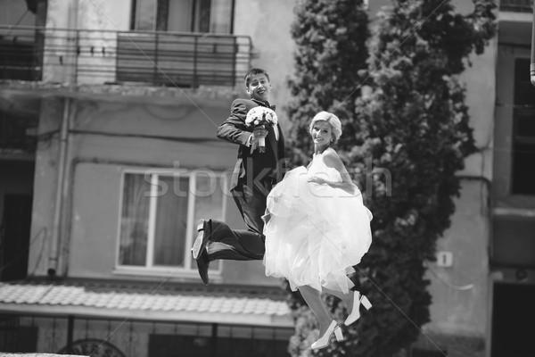 couple jumping on the street Stock photo © tekso