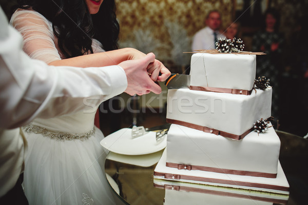 bride and groom is cutting cake Stock photo © tekso