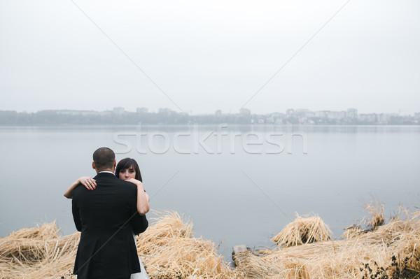 Wedding couple at the lake shore Stock photo © tekso