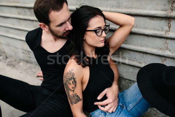 Adam kadın poz gri duvar kamera Stok fotoğraf © tekso