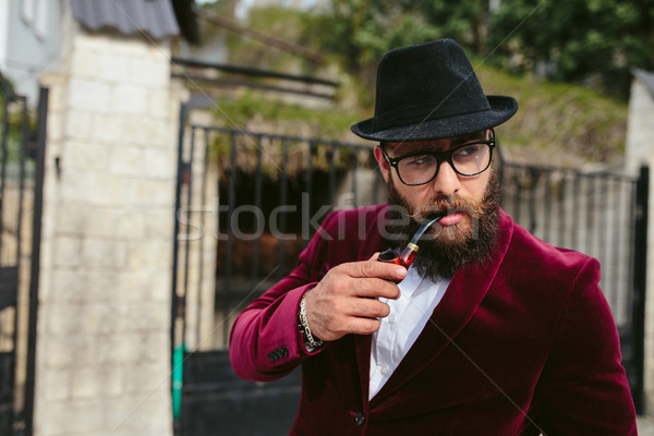 rich man with a beard smokes cradle Stock photo © tekso