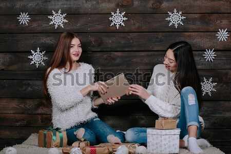 Two beautiful girls siting on the floor Stock photo © tekso