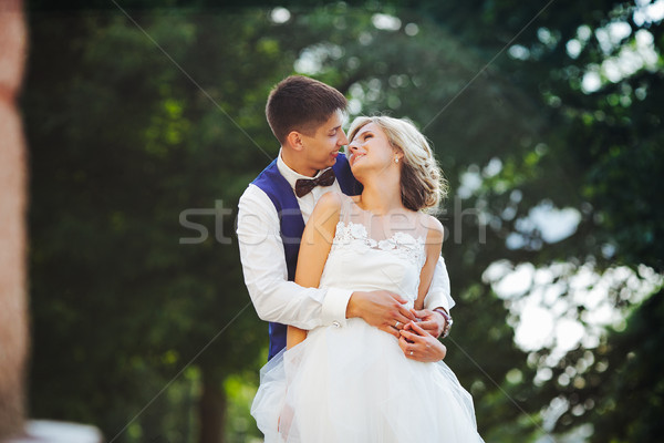 Beautiful wedding couple hugging in the park Stock photo © tekso
