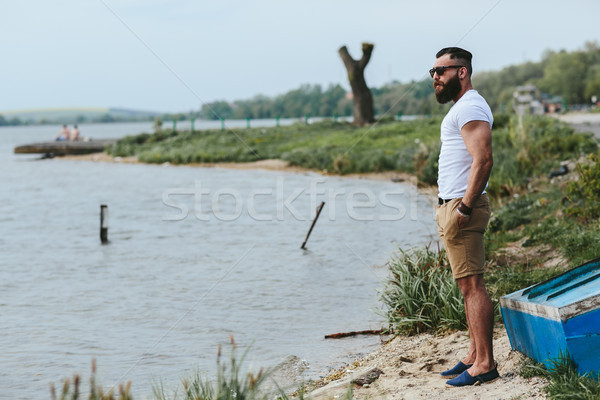 American Bearded Man looks on the river bank Stock photo © tekso
