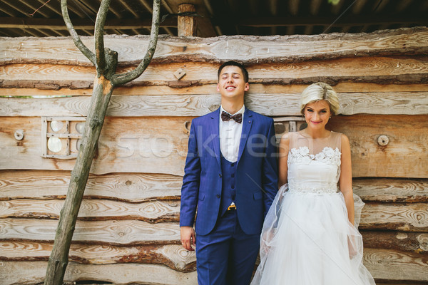 beautiful young wedding couple stands near house Stock photo © tekso