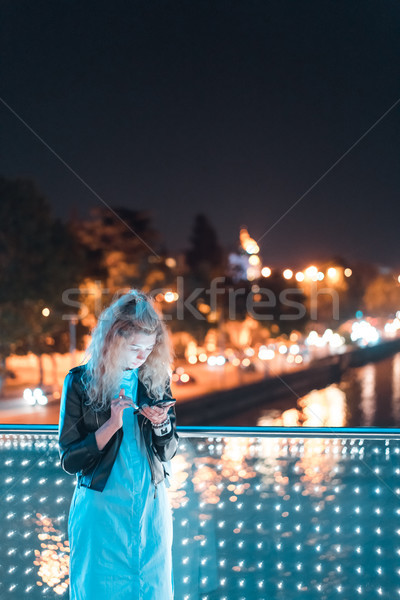Girl with a smartphone on a bridge Stock photo © tekso