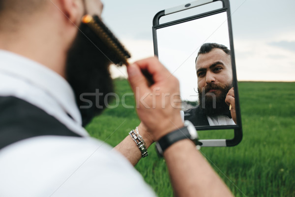bearded man preparing to shave in the field Stock photo © tekso