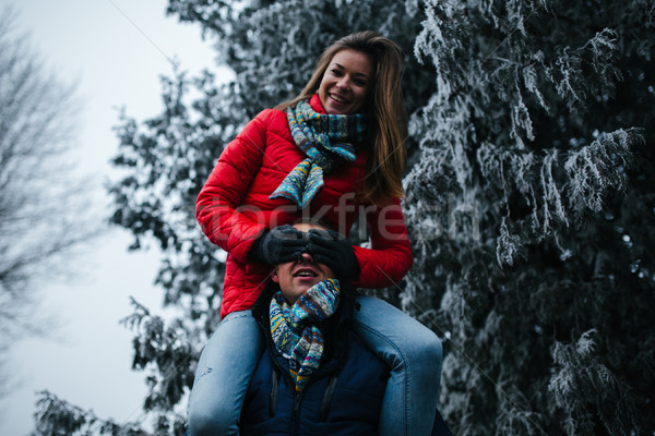 man carries his girlfriend on back Stock photo © tekso