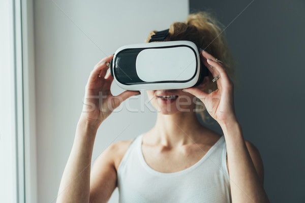 Woman in VR headset looking up Stock photo © tekso