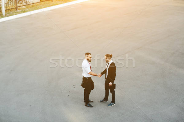 Two businessmen shaking hands Stock photo © tekso