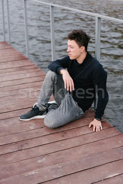 Genç oturma ahşap iskele kafkas bahar Stok fotoğraf © tekso