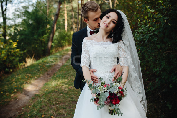 groom kisses the bride Stock photo © tekso
