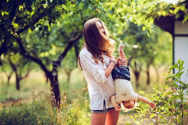 mom and little girl having fun Stock photo © tekso