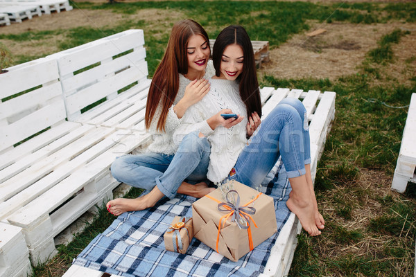 Stock photo: Two girls make selfie with gifts