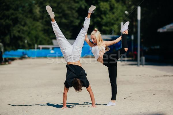man and woman performing tricks Stock photo © tekso