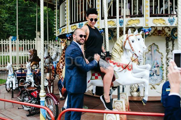 Volwassen man vrouw carrousel vrolijk meisje Stockfoto © tekso