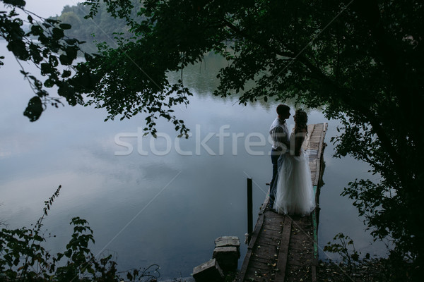 Stock photo: Wedding couple on the old wooden pier