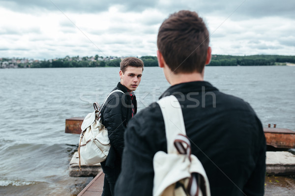 two young guys standing on a pier Stock photo © tekso
