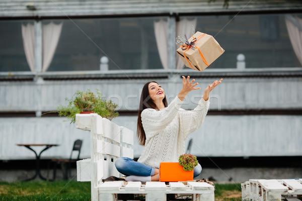 Young girl throws a gift Stock photo © tekso