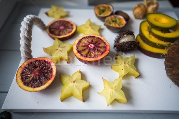 Exótico fruto frutas bandeja luz vermelho Foto stock © tekso