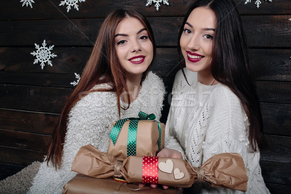 Two beautiful girls offer gifts to camera Stock photo © tekso