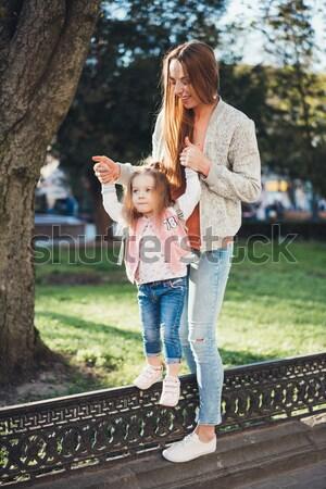 девочку ходьбе парка мало красивая девушка девушки Сток-фото © tekso