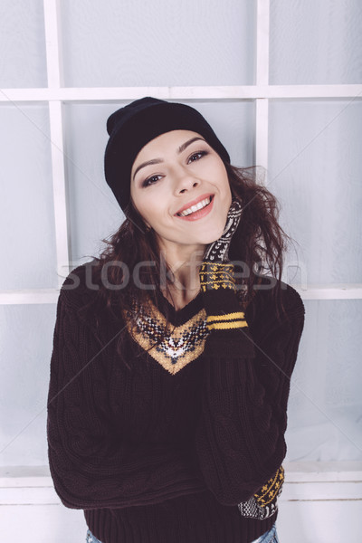 Cute girl in winter outfit posing for the camera Stock photo © tekso