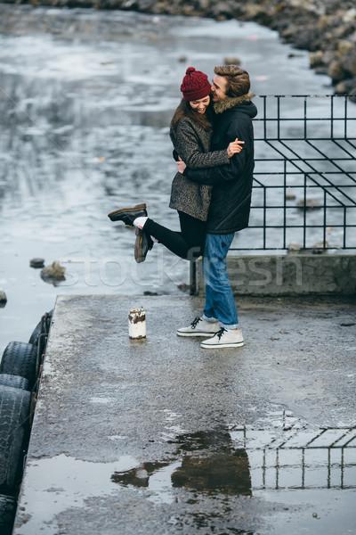 Gyönyörű pár szórakozás móló tó kéz Stock fotó © tekso