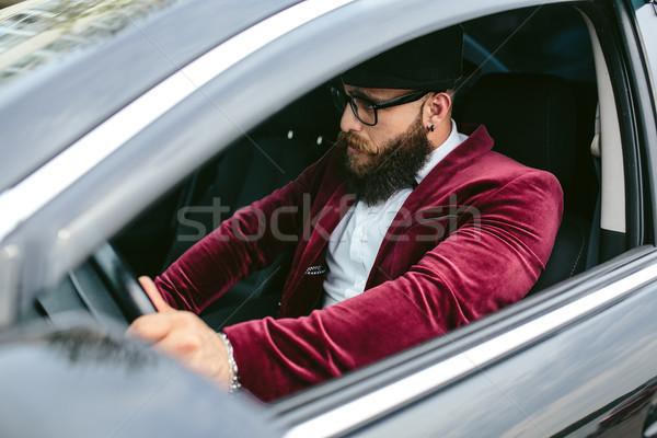 Man with beard driving a car Stock photo © tekso