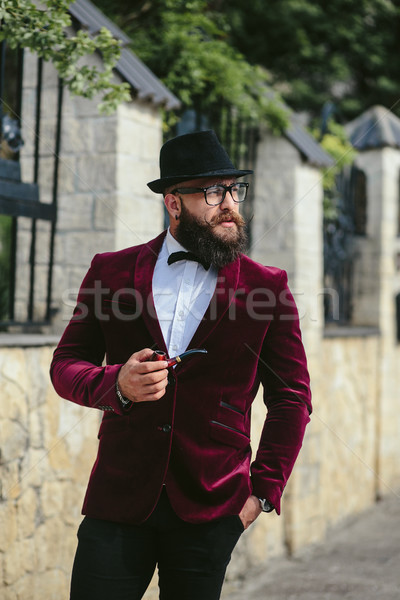 rich man with a beard, thinking about business Stock photo © tekso
